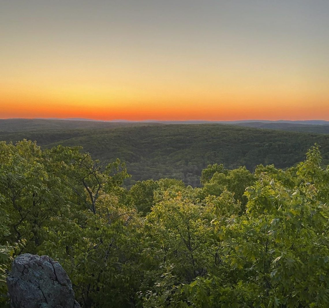 view of the sunset from the top of Bell Mountain